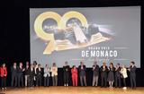 "GP La légende 4 - T.S.H. Prince Albert II and Princess Charlene surrounded by the key players involved in the documentary ""Monaco Grand Prix: The Legend"" © Government Communication Department / Manuel Vitali"