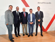 Monaco Extended - H.S.H. Prince Albert II surrounded by, on the left, Luc Jacquet, director, and Frédéric Genta, Country Chief Digital Officer, and on the right, Cédric Biscay, Director of Shibuya Productions, and Thomas Battaglione, CEO of SMEG. ©Direction / Manuel Vitali